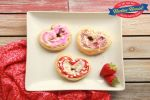 Heart Cinnamon Pastry Rolls on plate with wooden background