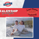 Sweet Manna Fundraising Dealership Spotlight - Duane and wife on beach with dealer logo and butter braid log on gray and blue background