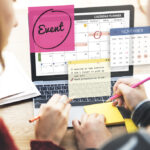 Tips for Fundraising Leaders - two people looking at computer screen with transparent images popping out about events, calendars, and notes