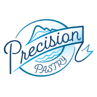 Precision Pastry logo - blue mountain and water with Precision Pastry written over top in a circular design